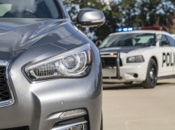 A police vehicle stops a sedan on a routine traffic stop photo by ASP Inc/Adobe Stock