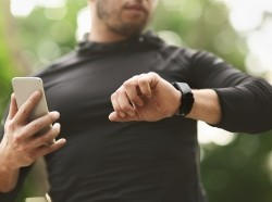 A man using wearable sensor technology, photo by Prostock-Studio/Getty Images