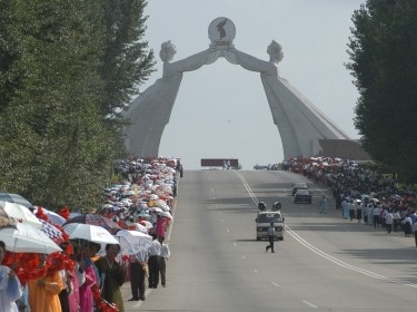People take part in the celebrations for the National Liberation Day near the Arch of Reunification in the city of Pyongyang, North Korea, August 14, 2005, photo by Yuri Maltsev/Reuters