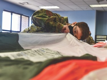 Senior Airman Brittany Arrasmith, 19th Operation Support Squadron Aircrew Flight Equipment technician, inspects a BA-30 parachute at Little Rock Air Force Base, Arkansas, Nov. 23, 2020. A handful of AFE Airmen, chosen based on their parachute rigging ability and experience, were sent to hands-on training for five days coordinated by Air Mobility Command to learn about the fundamentals, build up, inspection and repack of the low profile parachute, photo by Airman 1st Class Isaiah Miller/U.S. Air Force