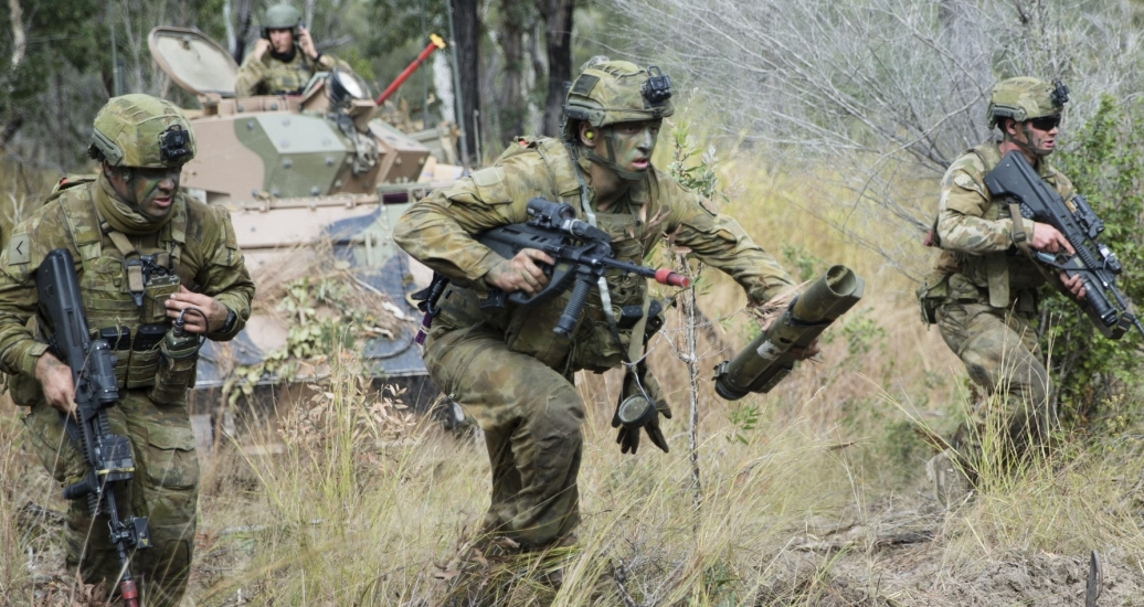 Australian soldiers from Battlegroup War Horse take part in the final assault on Williamson Airfield in the Shoalwater Bay Training Area, Rockhampton, Queensland, during Exercise Hamel, June 27, 2018, photo by U.S. Army