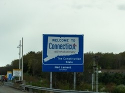 Welcome to Connecticut highway sign, photo by Rabbitti/Getty Images