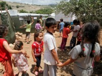 Syrian refugee children in the Ketermaya refugee camp, outside Beirut, Lebanon on June 1, 2014, photo by Dominic Chavez/World Bank
