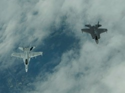 Two U.S. Air Force F-35A Lightning II fighter aircraft, assigned to the 421st Fighter Squadron, Hill Air Force Base, Utah, right, fly in formation with two Finnish F-18 Hornets, left, while en route to Turku, Finland, June 13, 2019, photo by Airman 1st Class Jovante Johnson