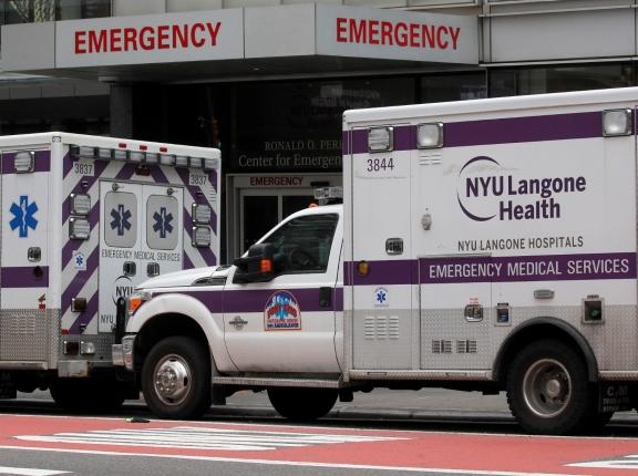 Ambulances seen outside NYU Langone Hospital's Emergency entrance during the coronavirus disease (COVID-19) outbreak, in New York City, March 31, 2020, photo by Brendan McDermid/Reuters