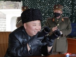 North Korean leader Kim Jong Un visits a drill of long-range artillery sub-units of the Korean People's Army, March 2, 2020, photo by KCNA/Reuters