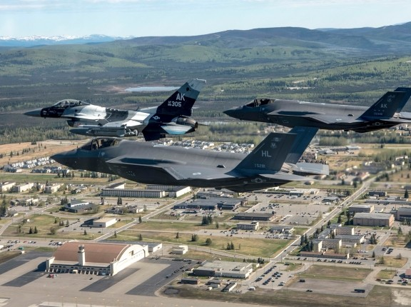 An F-16 Fighting Falcon an F-35A Lightning II from Eielson Air Force Base and an F-35A from Hill Air Force Base, Utah, fly over the installation in Alaska, May 15, 2020. With the arrival of the F-35As, the 354th Fighter Wing is now home to fourth and fifth-generation fighter aircraft, photo by Tech. Sgt. Jerilyn Quintanilla/U.S. Air Force