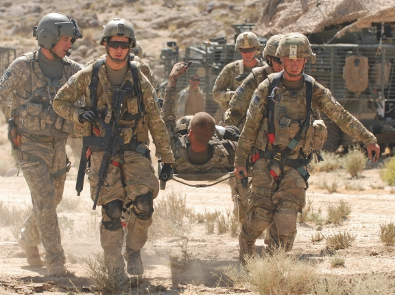 U.S. Army Pfc. Shawn Williams of the 1st Stryker Brigade Combat Team, 25th Infantry Division, based in Fort Wainwright, Alaska, gives the thumbs-up to members of his unit as he is evacuated after being injured by a roadside bomb, Friday, June 17, 2011, in the Kandahar province of Afghanistan.U.S. Army Pfc. Shawn Williams of the 1st Stryker Brigade Combat Team, 25th Infantry Division, based in Fort Wainwright, Alaska, gives the thumbs-up to members of his unit as he is evacuated after being injured by a roadside bomb, Friday, June 17, 2011, in the Kandahar province of Afghanistan, photo by Lt.j.g. Haraz Ghanbari/U.S. Army