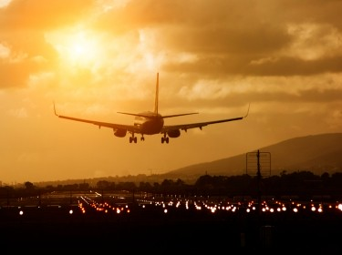 Airplane about to land on a runway in Cape Town, South Africa, photo by brazzo/Getty Images