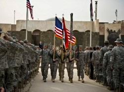 The colors are retired during a ceremony marking the end of the U.S. mission in Iraq in Baghdad on December 15, 2011, photo by Erin A. Kirk-Cuomo/U.S. Department of Defense