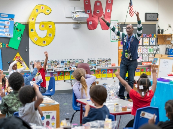 Teacher Jonathan Clausell conducts a math lesson as his students finish eating in his pre-K class at C.A. Weis Elementary Community Partnership School in Pensacola, Florida, Friday, March 5, 2021, photo by Gregg Pachkowski for USA Today via Reuters
