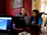 Jennifer Panditaratne helps Hazeline with her reading assignments as she is homeschooling in Broward County, Florida, U.S. May 29, 2020. Picture taken May 29, 2020