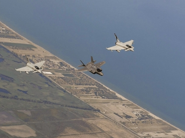 Italian air force F-35 and Eurofighter Typhoons fly in formation over Italy during a training mission, courtesy photo, U.S. Air Forces in Europe and Air Forces Africa