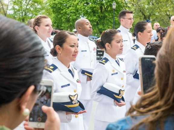 Members of a U.S. Coast Guard Officer Candidate School class and an NOAA Basic Officer Training Course class at a graduation ceremony May 9, 2017, photo by PO3 Nicole Barger/U.S. Coast Guard