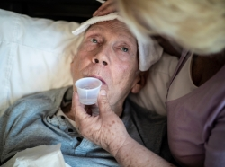 Elderly man drinking medicine, photo by LPETTET/Getty Images