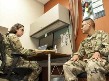 A nurse practitioner asks health-related questions during a session on a U.S. Army Base