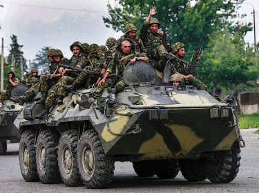 Russian soldiers aboard an armoured vehicle in western Georgia in AUgust of 2008
