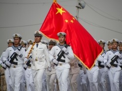 Naval personnel from China's base in Djibouti, participate in a military parade in Djibouti City