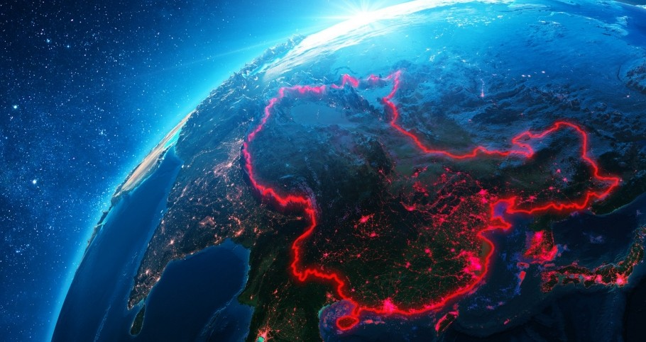 China outlined in red on a NASA image of Earth, photo by NASA and RomoloTavani/Getty Images