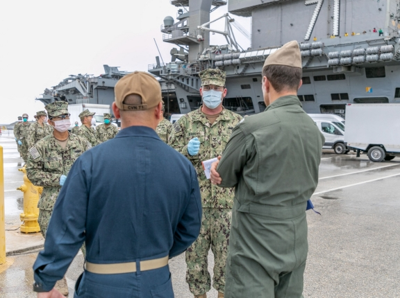 Seabees coordinate transportation of sailors assigned to the aircraft carrier USS Theodore Roosevelt who have tested negative for COVID-19 from Naval Base Guam to military-approved commercial lodging, in Guam, April 3, 2020, photo by MC Matthew R. White/U.S. Navy via Reuters