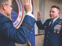 Col. Darren Brumfield, right, Air Force Global Strike Command chief of intercontinental ballistic missile (ICBM) and helicopter maintenance division, recites the oath of office during his promotion ceremony at Barksdale Air Force Base, La., Nov. 30, 2020. The oath of office cites, Air Force officers will support and defend the Constitution of the United States against all enemies, foreign and domestic, photo by Staff Sgt. Philip Bryant/U.S. Air Force