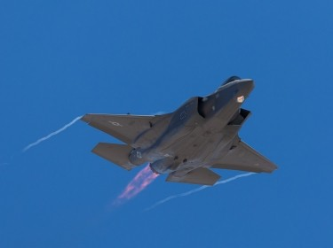 F-35 Lightning II  approaching  with afterburner on and condensation trails at the wings tip, photo by rancho_runner/Getty Images/iStockphoto