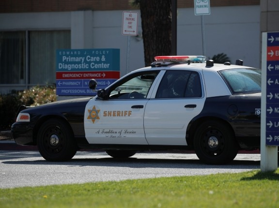 A Los Angeles County Sheriffs vehicle patrols the Harbor-UCLA Medical Center in Torrance, California, February 24, 2021, photo by Mike Blake/Reuters