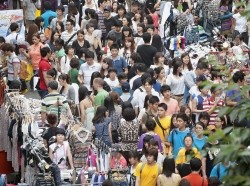 A throng of shoppers in Myungdong, downtown Seoul, South Korea, July 17, 2011, photo by United Nations/CC BY-NC-ND 2.0