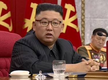 North Korean Leader Kim Jong Un speaks at a plenary meeting of 8th central committee of the Workers' Party of Korea in this still image taken from KRT footage on June 16, 2021, photo by KRT TV/Reuters