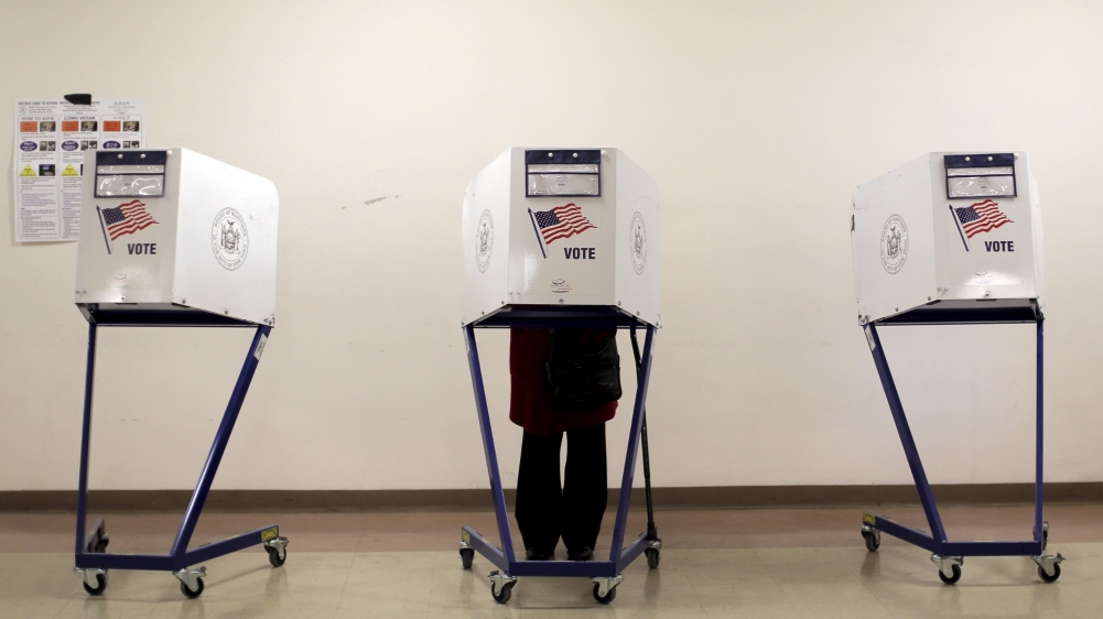 A voter is seen at a polling station during New York primary elections