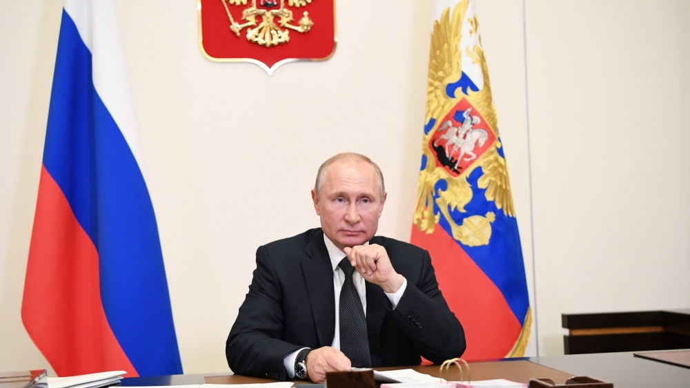 Russian President Vladimir Putin takes part in a video conference call