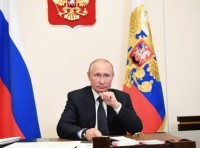 Russian President Vladimir Putin takes part in a video conference call with officials and public representatives of the region of Dagestan amid the coronavirus disease (COVID-19) outbreak at the Novo-Ogaryovo state residence outside Moscow, Russia May 18, 2020, photo by Alexei Nikolsky/Reuters