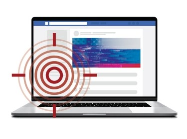 Laptop depicting Russian propaganda on Facebook with a bullseye mark, images by guteksk7, iiierlok_xolms, carmelod, and FishPouch/Adobe Stock
