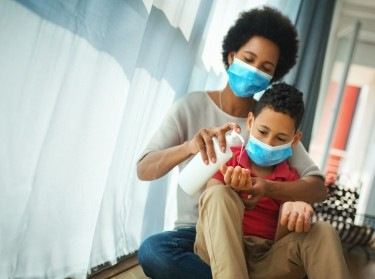 Mother and son in pandemic quarantine, photo by gilaxia/Getty Images