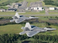 Two U.S. Air Force F-22 Raptors fly over Joint Base Langley-Eustis' Felker Army Airfield at Fort Eustis, Virginia, June 12, 2018. Felker Army Airfield represents the success of consolidating Army and Air Force operations through a joint base as the airfield continues to support aerial missions while being operated by the Air Force's 1st Operations Support Squadron, photo by Tech. Sgt. Natasha Stannard/U.S. Air Force