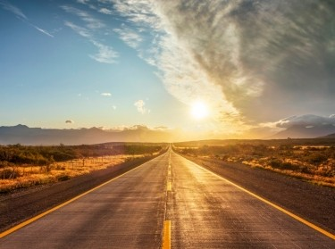 Highway headed toward the sun, photo by DieterMeyrl/Getty Images