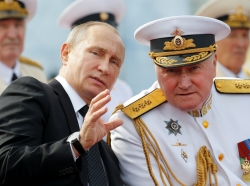 Russian President Vladimir Putin speaks with Commander-in-Chief of the Russian Navy Admiral Vladimir Korolev at the Navy Day parade in St. Petersburg, Russia, July 30, 2017, photo by Alexander Zemlianichenko/Reuters