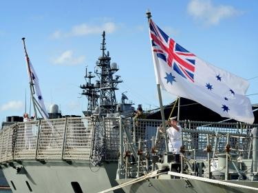 Australian sailors raise the colors aboard HMAS Darwin, photo by Royal Australian Navy photo by Cpl. Chris Dickson/Royal Australian Navy