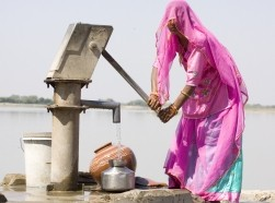 woman filling drinking water, Rajasthan , India