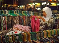Batik seller in traditional market, Yogyakarta, Indonesia