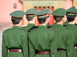 Unrecognizable group of soldiers standing in line and seen from behind. Wearing uniforms including caps. The soldiers belong to the Chinese armed forces, photo by FrankvandenBergh/AdobeStock