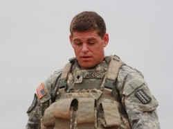 Spc. Luke Anderson is fatigued after marching six miles in full combat gear with body armor, a 50-pound rucksack and a basic load of ammunition for his weapon. On this day, he also carried the heavier weapon, the M249 SAW.