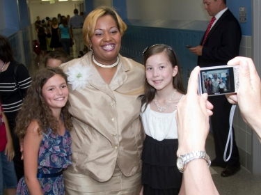 A Maryland elementary school principal poses for a photo with two fifth graders.