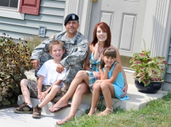 An Army family poses for a photograph