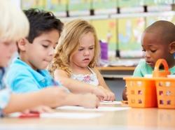 Preschool children working at table