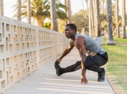 African American man stretching in the park in Los Angeles, California