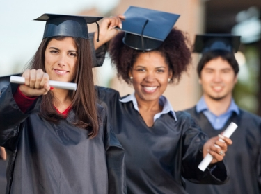 Female Students Showing diplomas