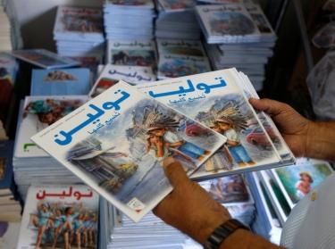 Israeli Saleh Abbasi holds children's books in his publishing house in the northern Israeli city of Haifa August 18, 2008