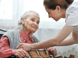 an elderly woman with a caretaker