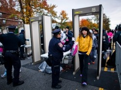 Runners pass through scanners as they are checked by New York Police Department officers upon arrival for the New York City Marathon, November 3, 2013